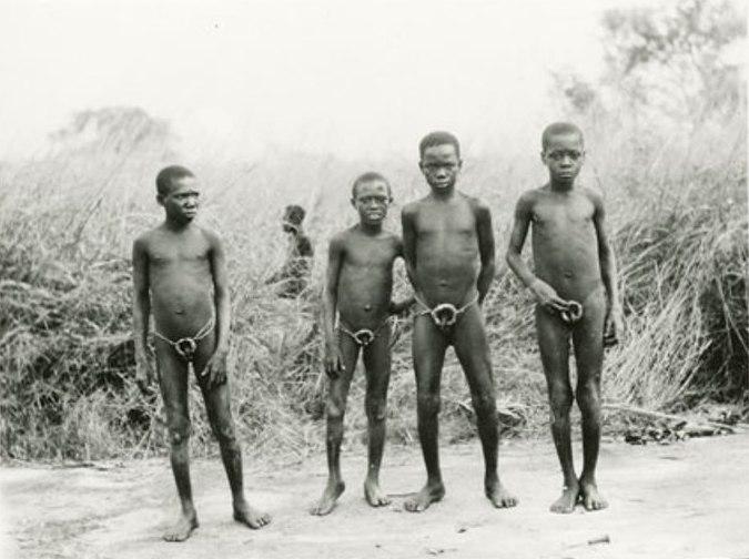 1517123cfb033 Four Azande boy circumcision initiates wearing penis-guards